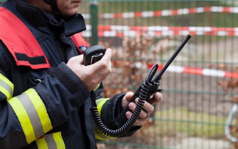 Fireman holding a walkie-talkie
