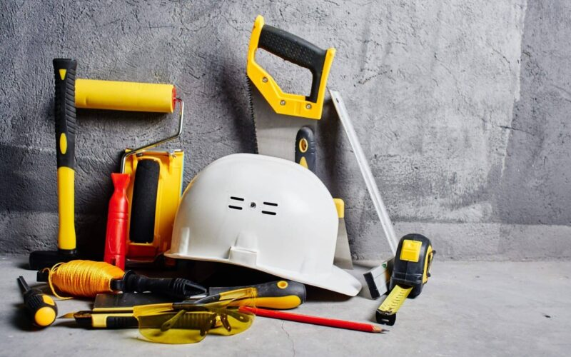 set of construction tools on a black wall background